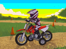 A kid on a mini dirt bike with training wheels getting trained