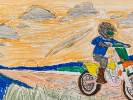 Dirt Bike Coloring Pages for kids - A colored page of a kid riding his KTM 50 on a off-road trail