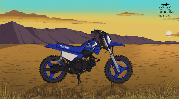 yamaha pw50 dirt Bike on off-roading area with mountain and sun in the background
