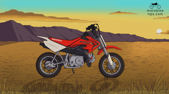 Red Honda 50cc Dirt Bike CRF50 on off-roading area with mountain and sun in the background