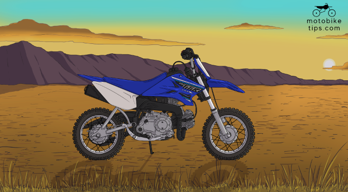 ttr50 specs yamaha's 50cc dirt Bike on off-roading area with mountain and sun in the background