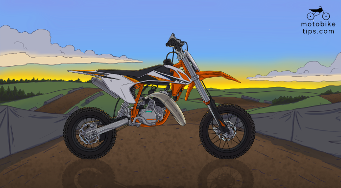 KTM 50 SX motocross dirt bike on a race track with sky and hills in the background